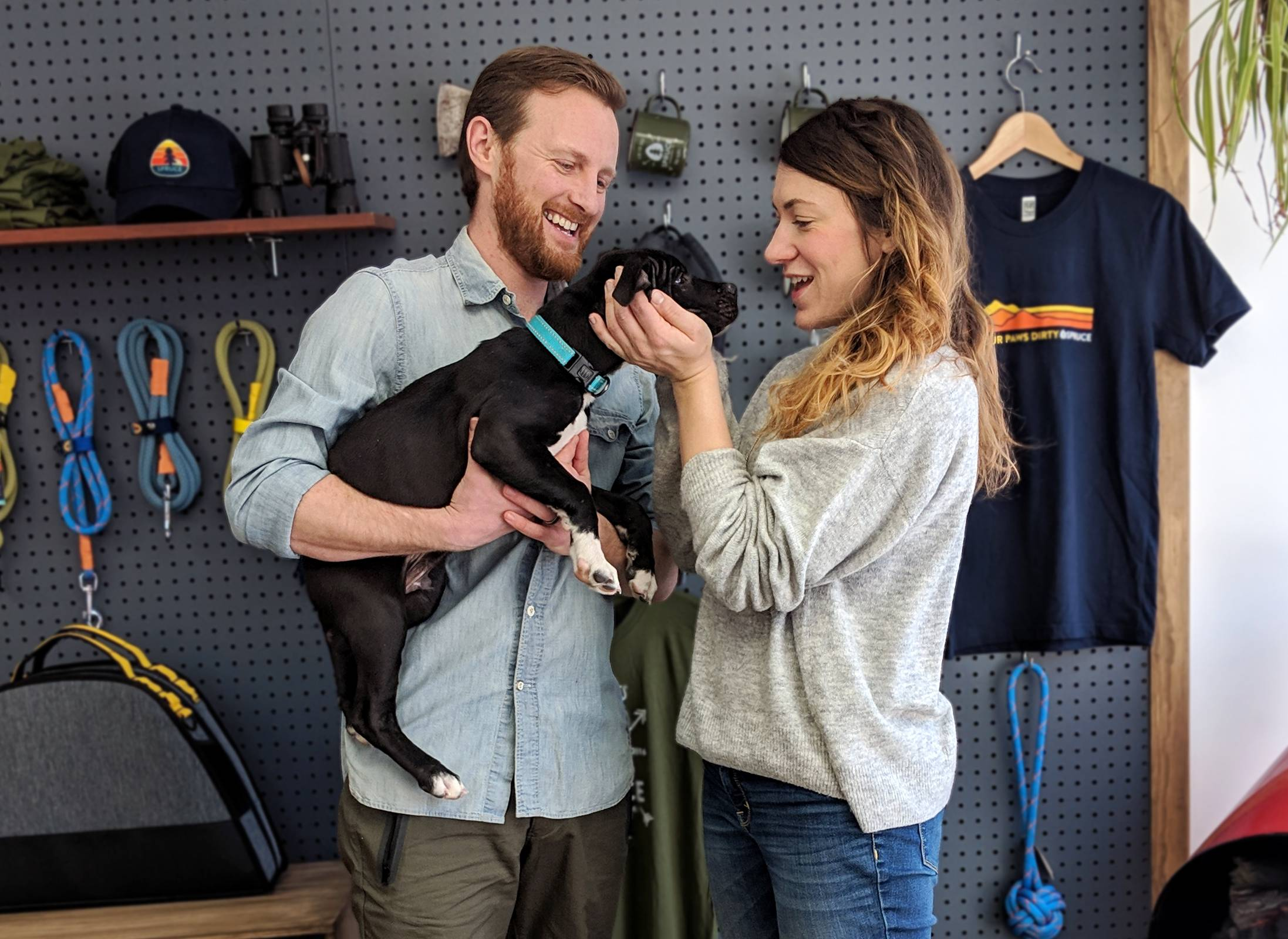 Spruce founders Eli and Leah together holding their puppy