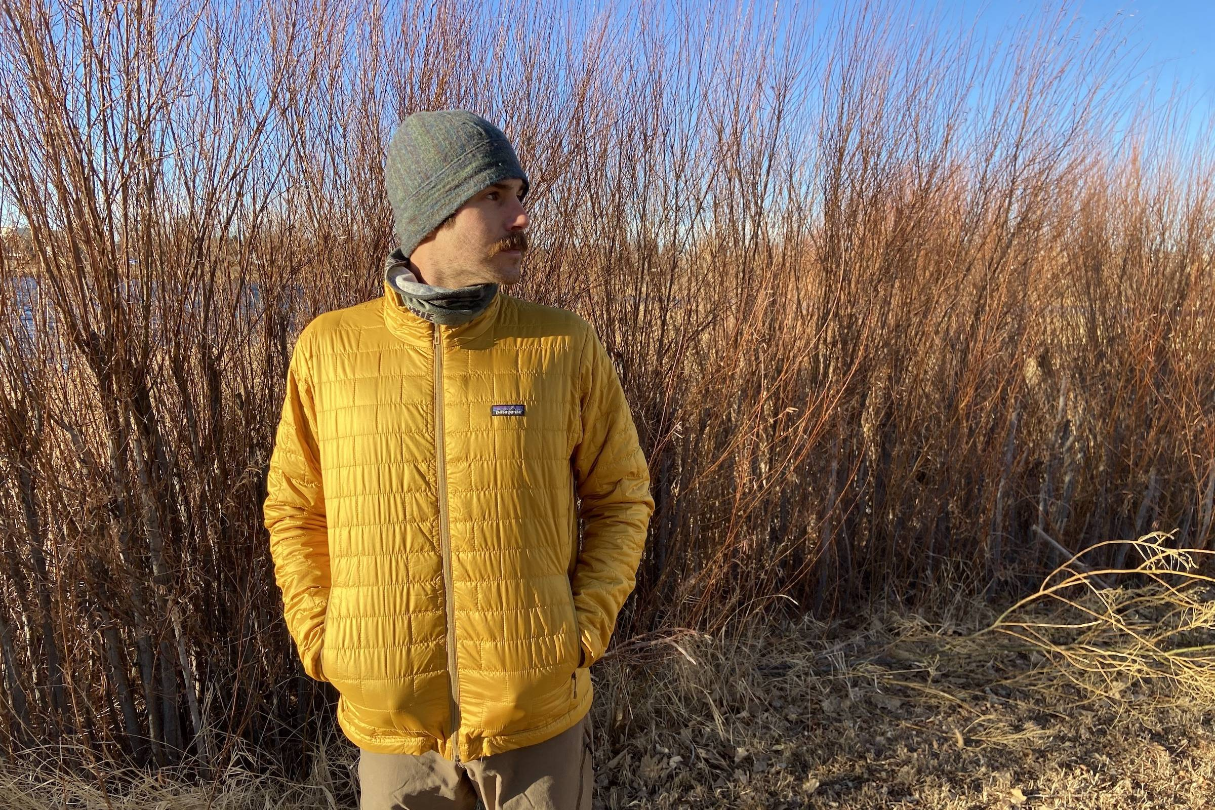 Man standing in gold Patagonia Nano Puff jacket outside