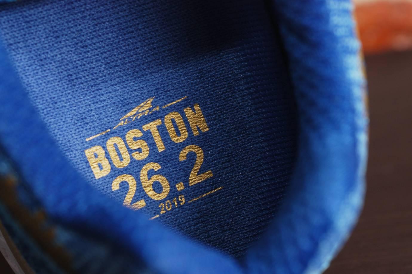 a label on the inside of an Altra Escalante Racer blue Boston Marathon edition shoe