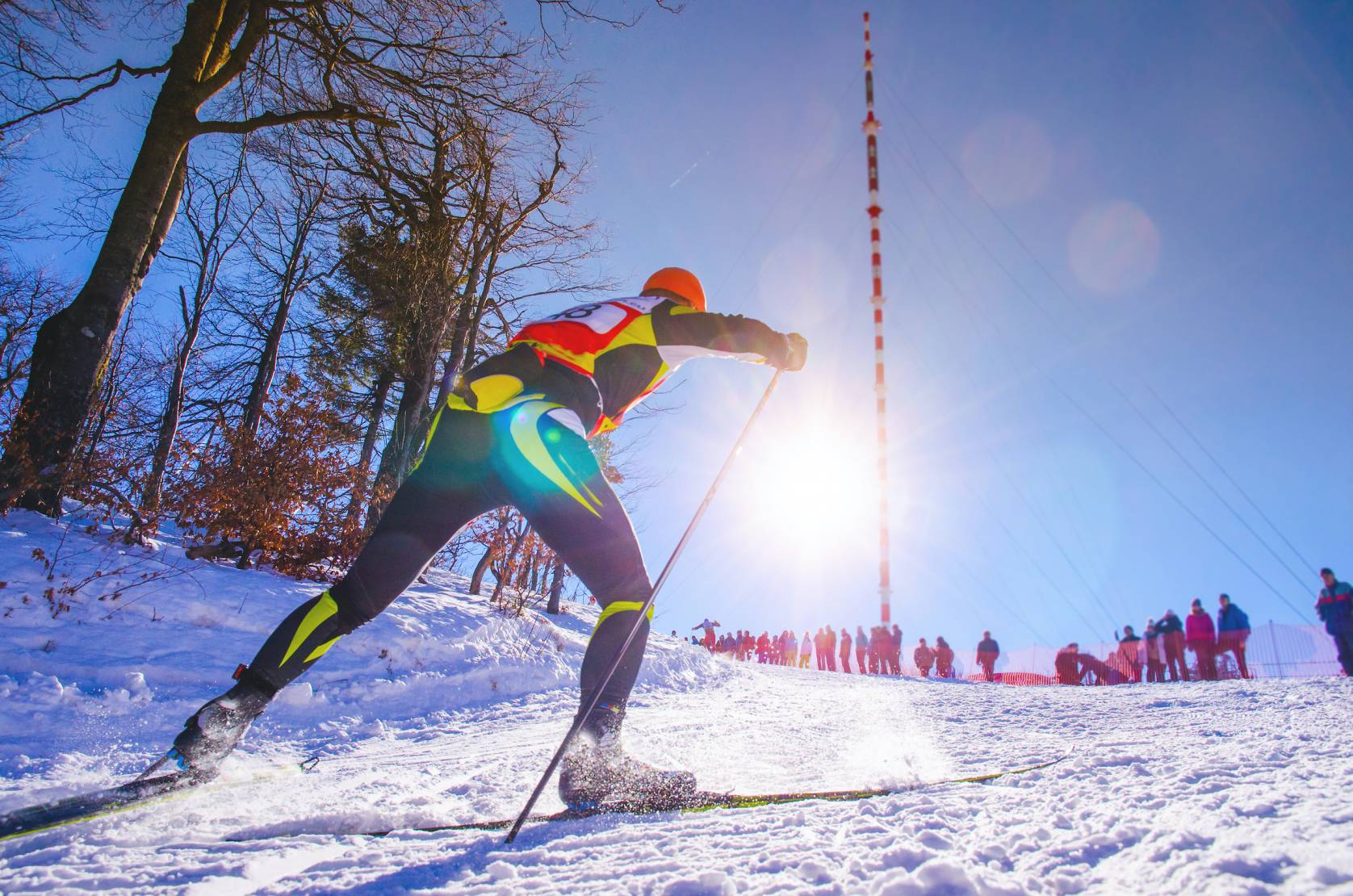 nordic skier traveling uphill training for Olympics