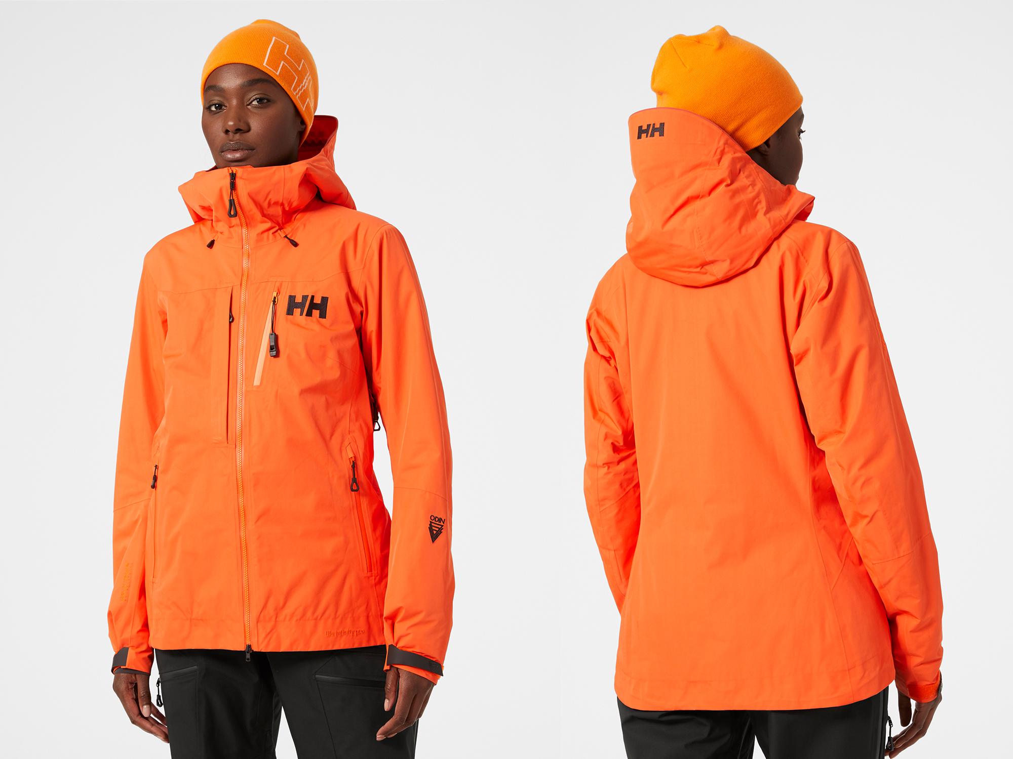 Black female model wearing neon orange Helly Hansen Infinity jacket