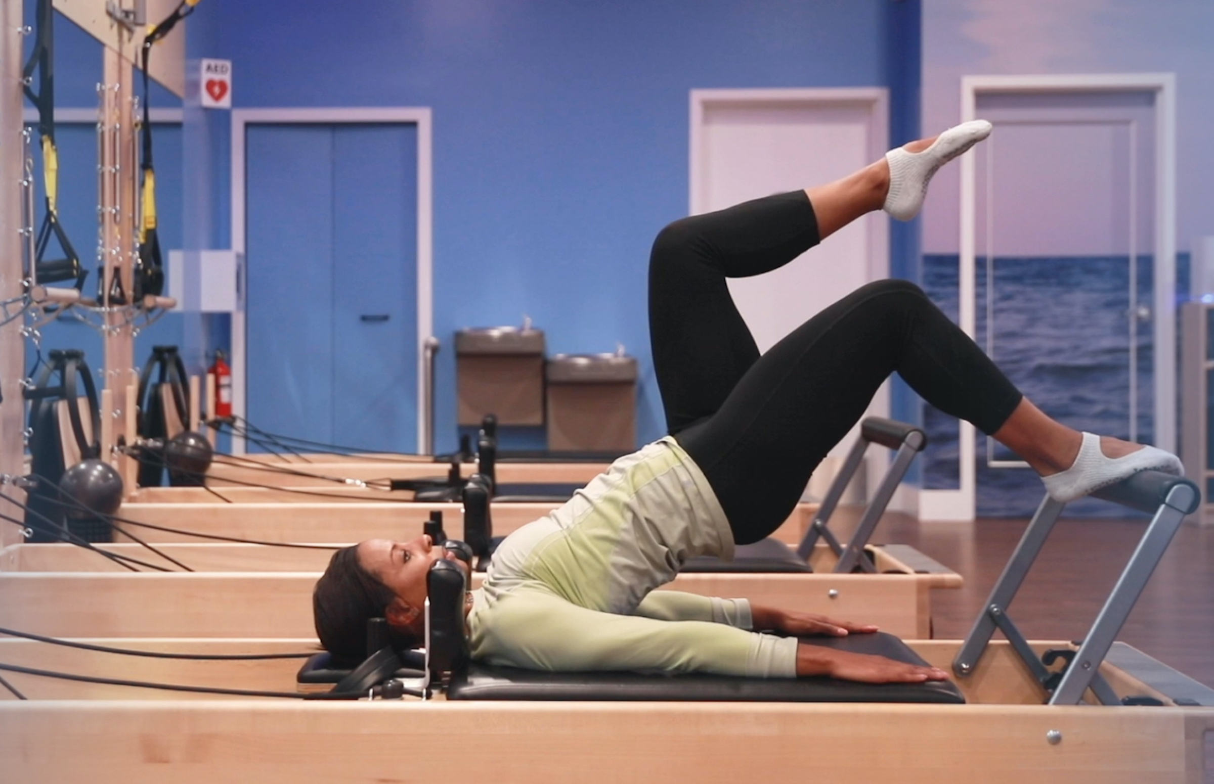 woman demonstrating pilates bridge exercise for skiers