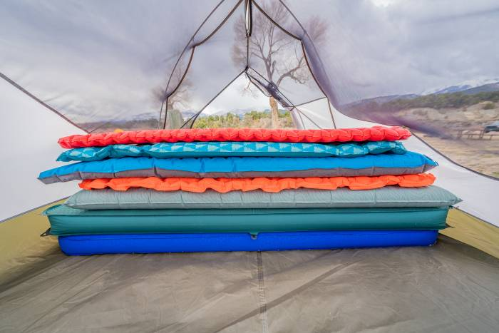 sleeping pads stacked inside tent