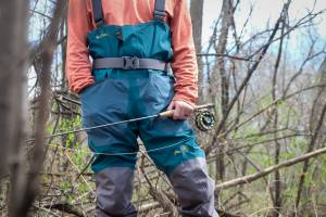 Person fishing in Simms Backcountry flyweight fly fishing waders lifestyle