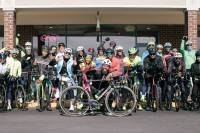 20 members of the Maryland Get It In Cycling Club post for a photo
