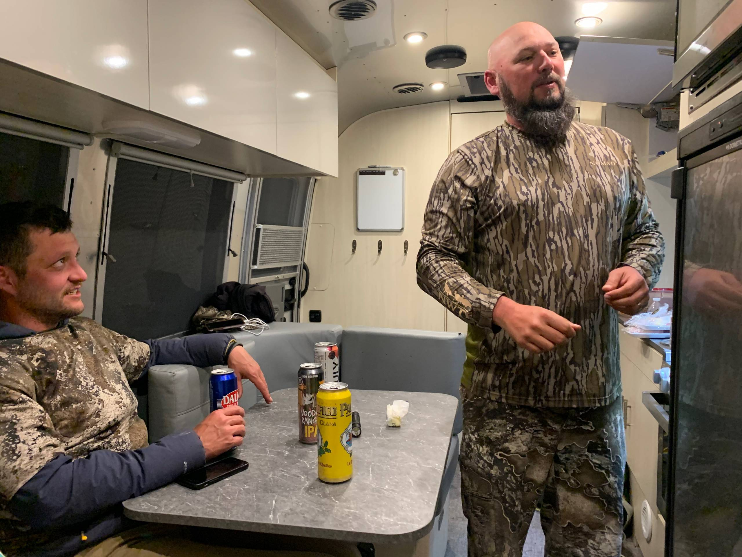 Men in camo inside the Airstream Flying Cloud 23FB
