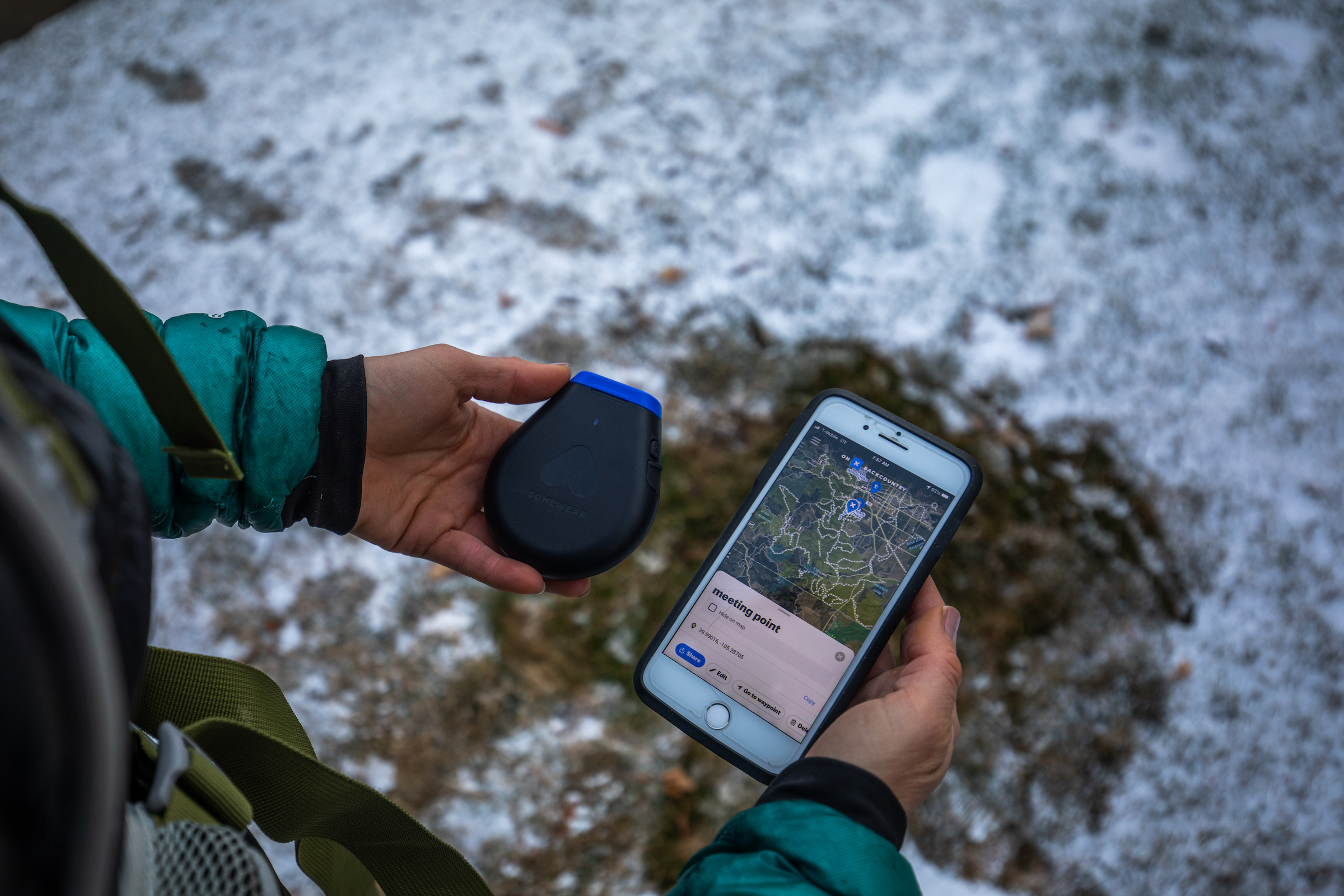 hiker using a Somewear hotspot and onX mapping app via smartphone
