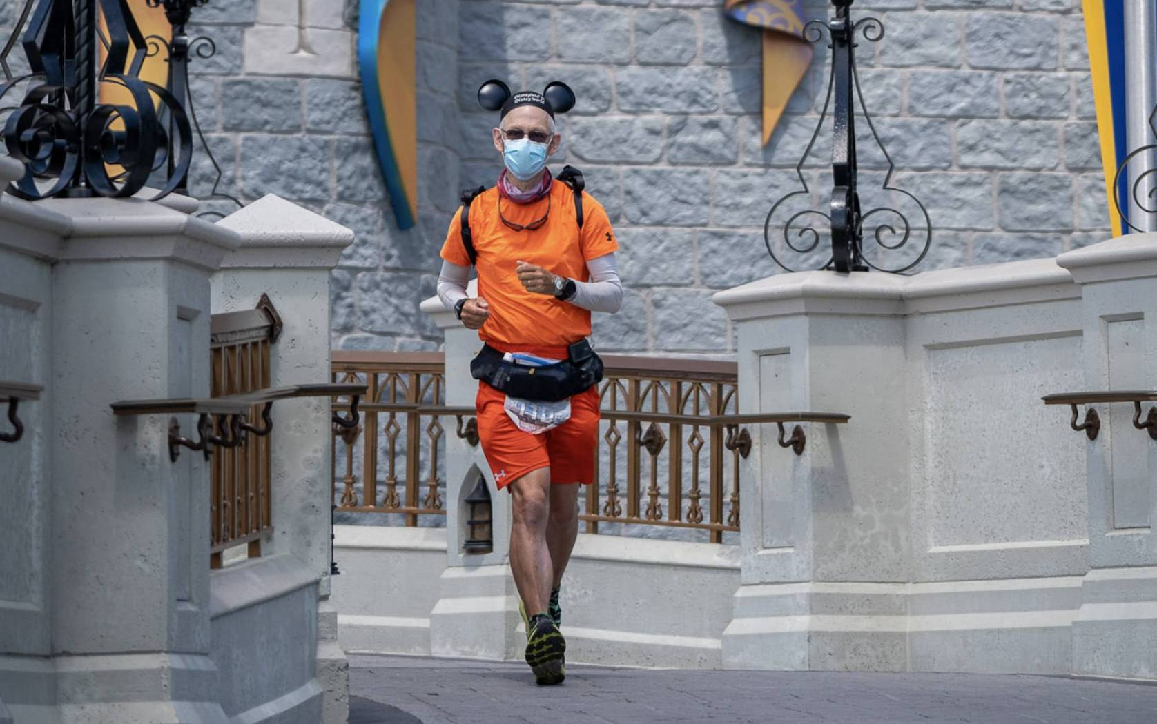 don muchow running in Mickey Mouse ears through Disney World