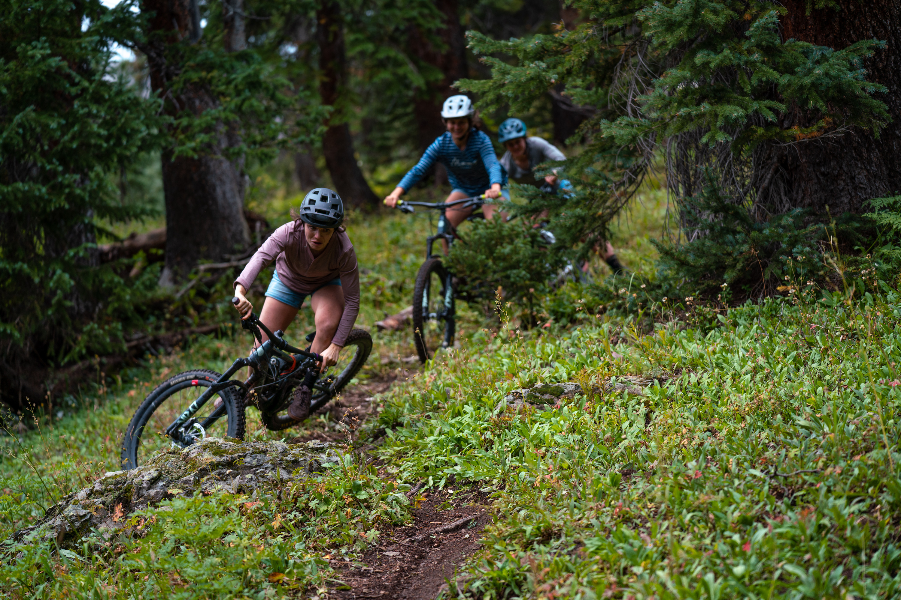 two girls riding singletrack trail in Colorado
