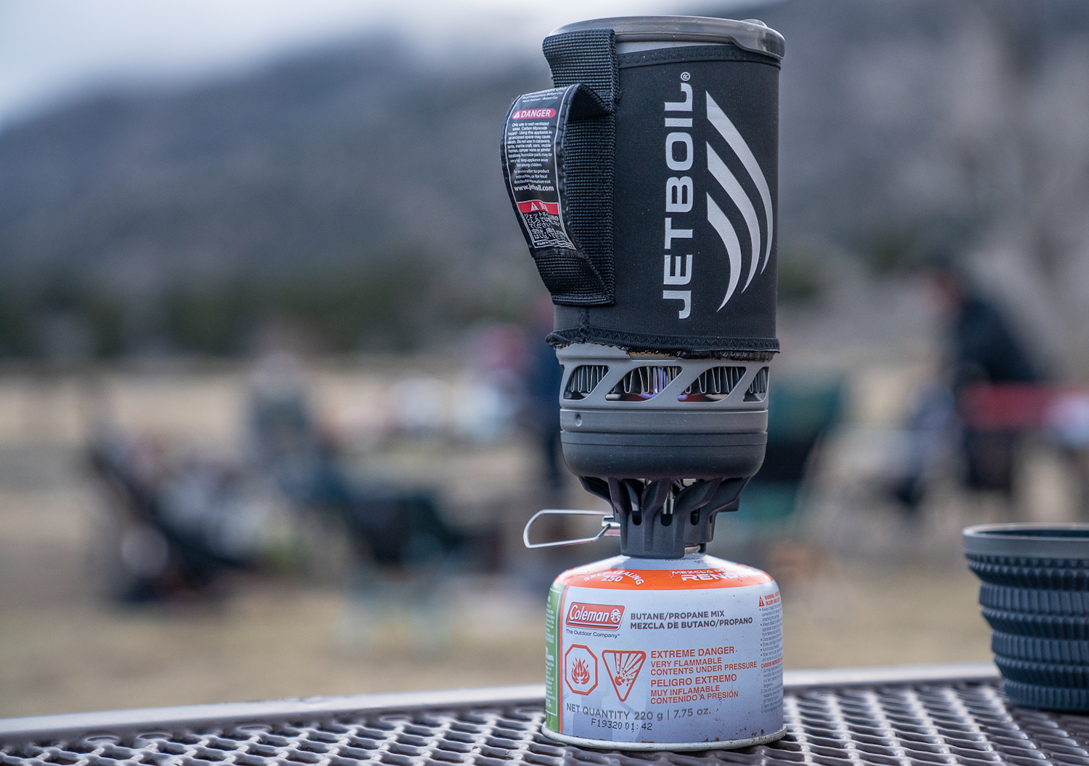 a jetboil stove system on a table at a campsite