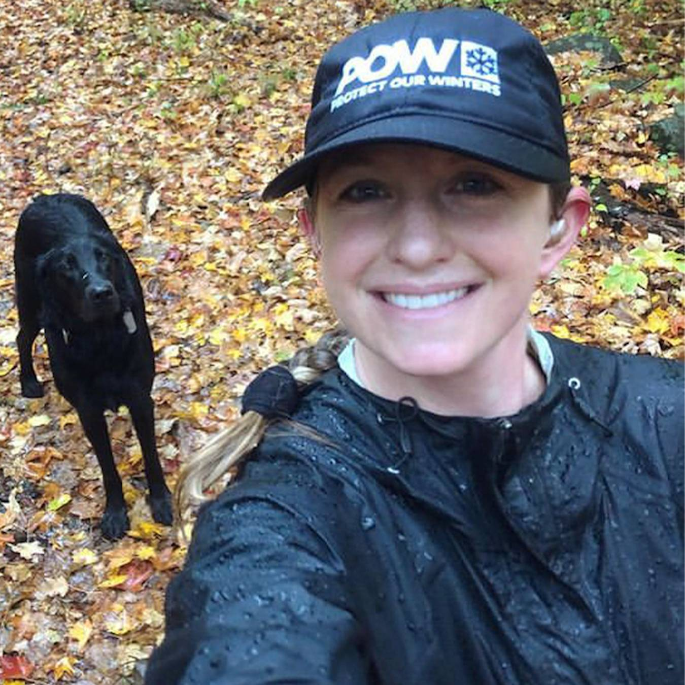 mercedes walker trail running with her black lab dog