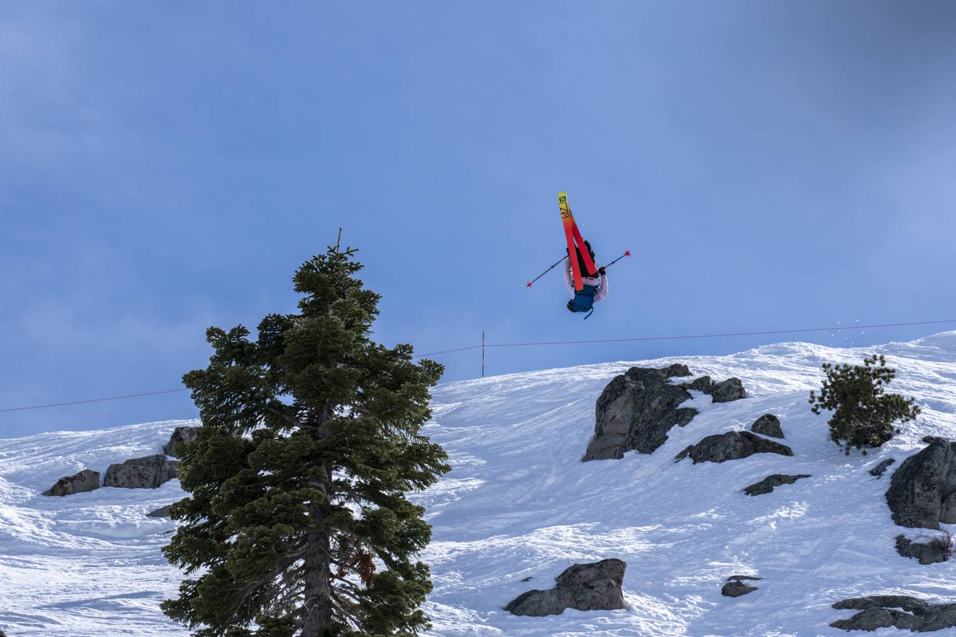 skier doing trick off rock at Red Bull Raid