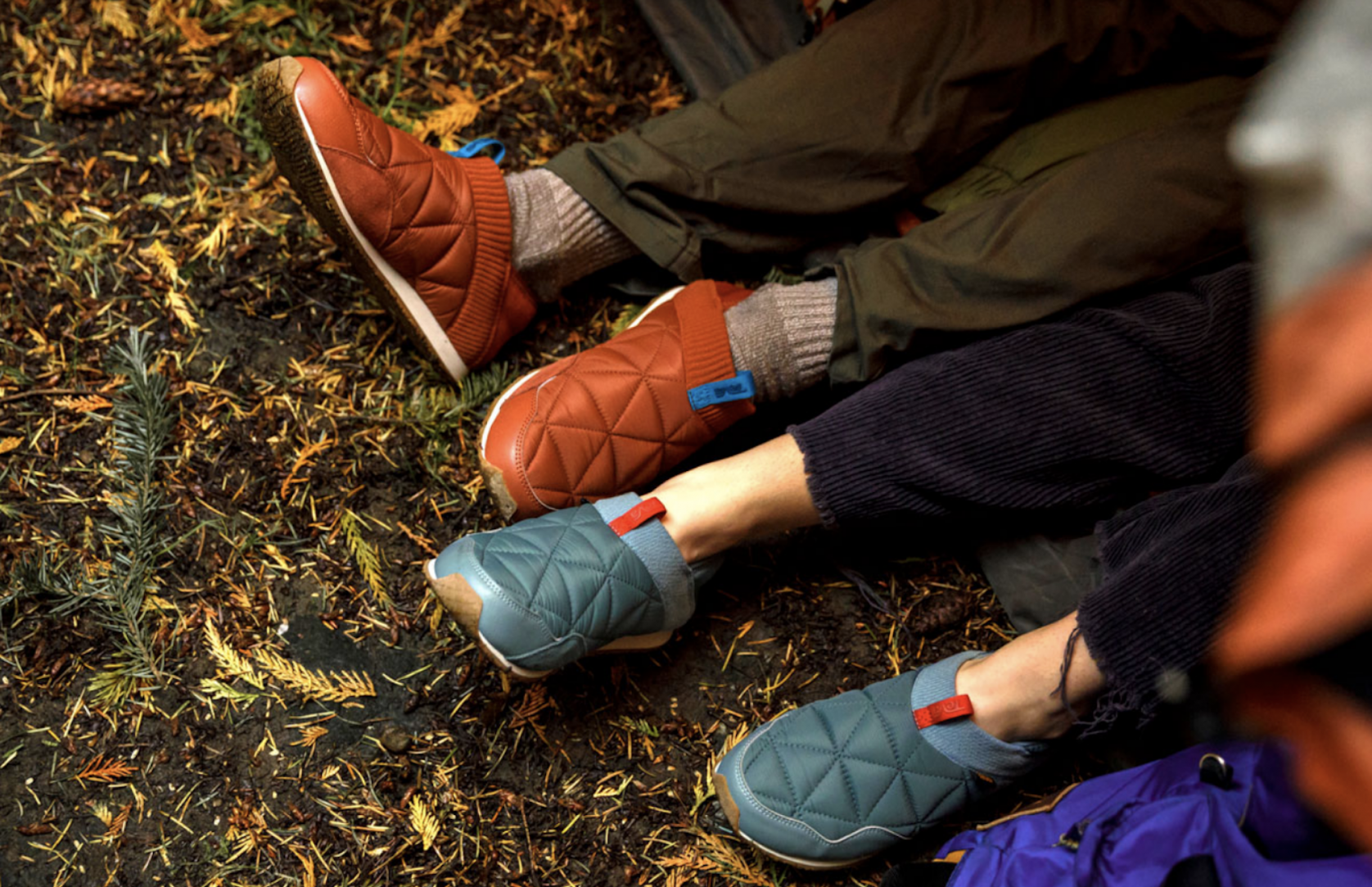 people wearing Teva ember moc camp shoes