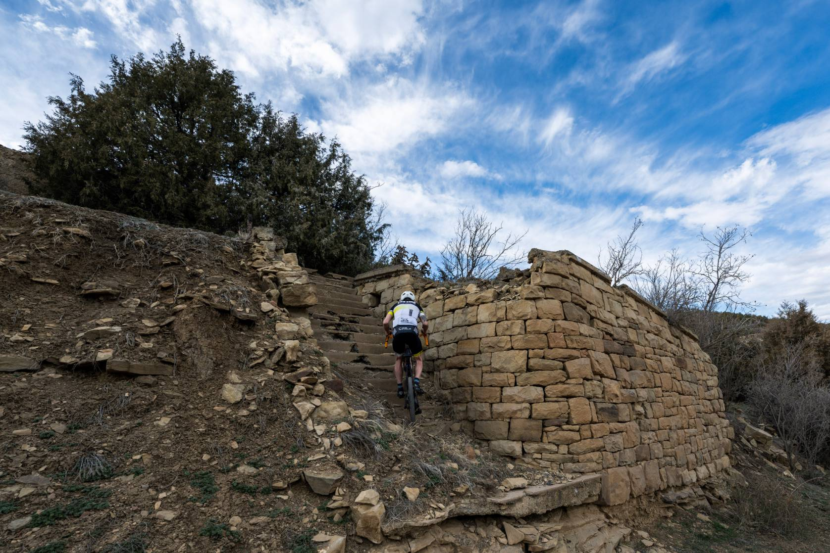 Cyclist riding up stair ruins in Trinidad, CO