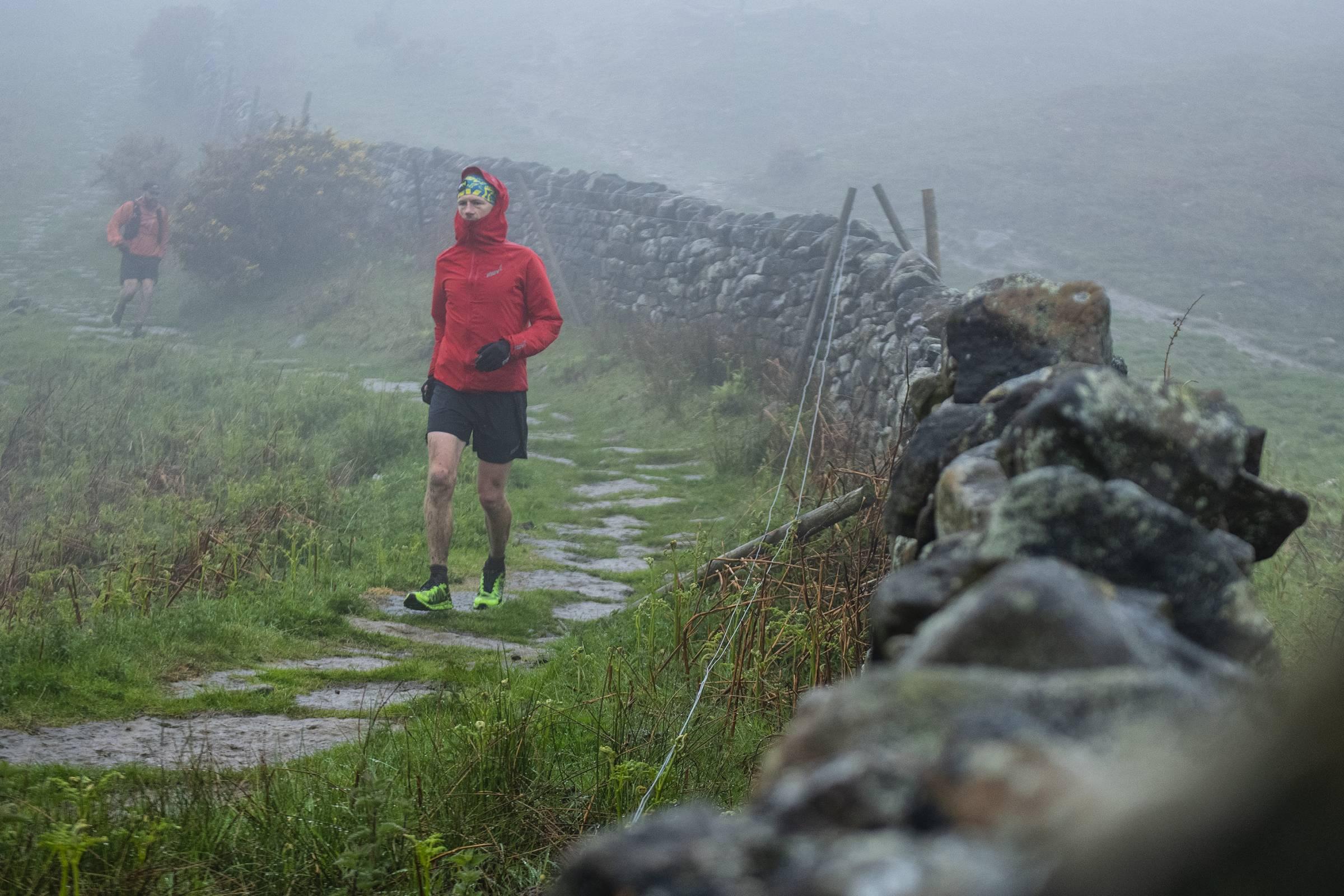 Damian Hall running on an English footpath in the rain