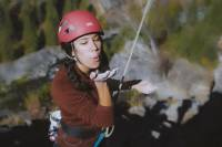color female climber blowing chalk from her hand