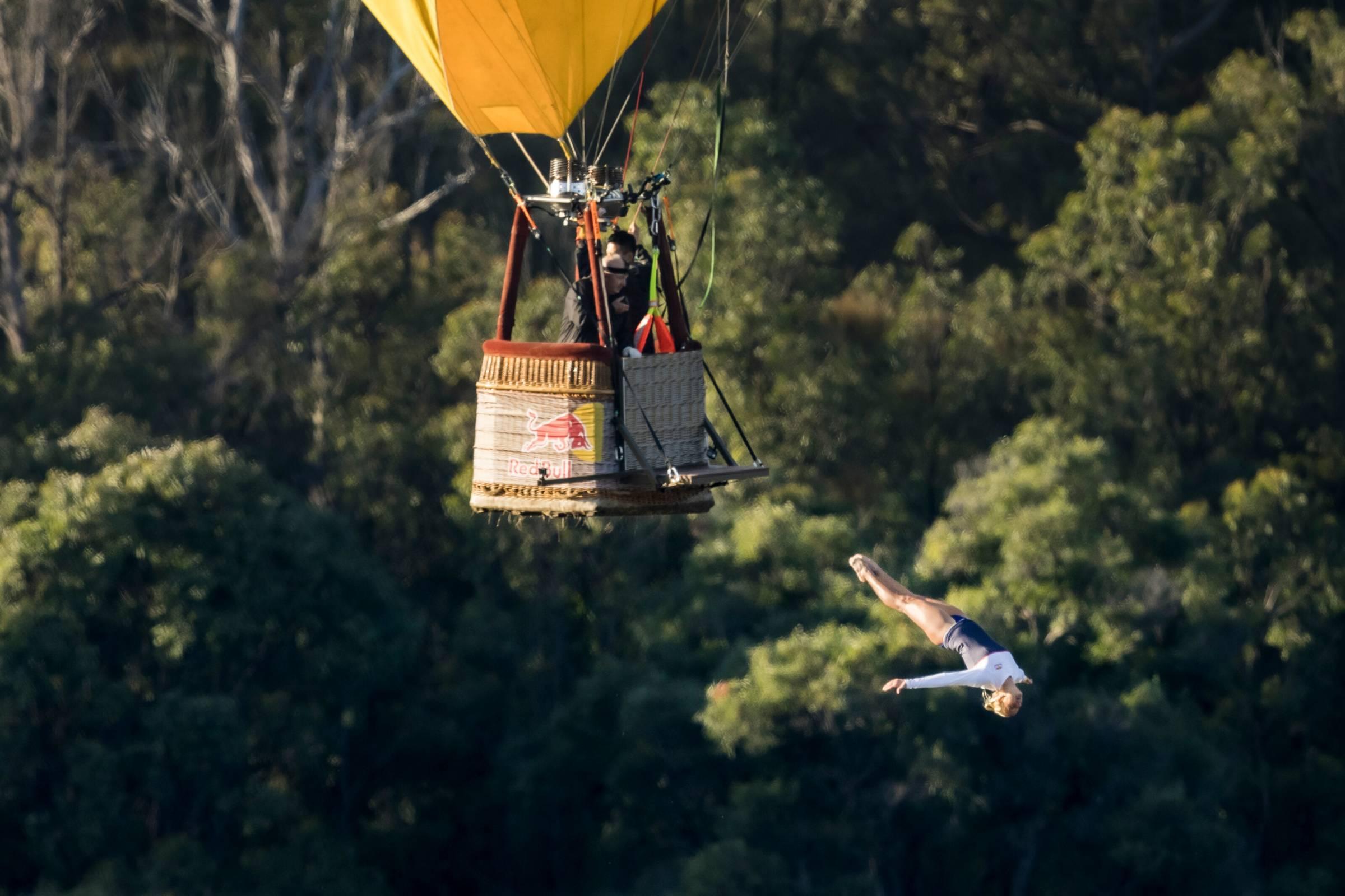 Cliff diver Rhiannan Iffland performs a high dive from a hot air balloon in Australia