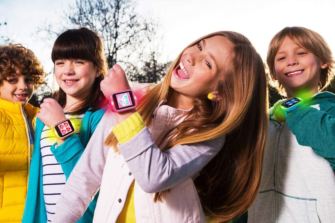 kids showing off their fitness trackers
