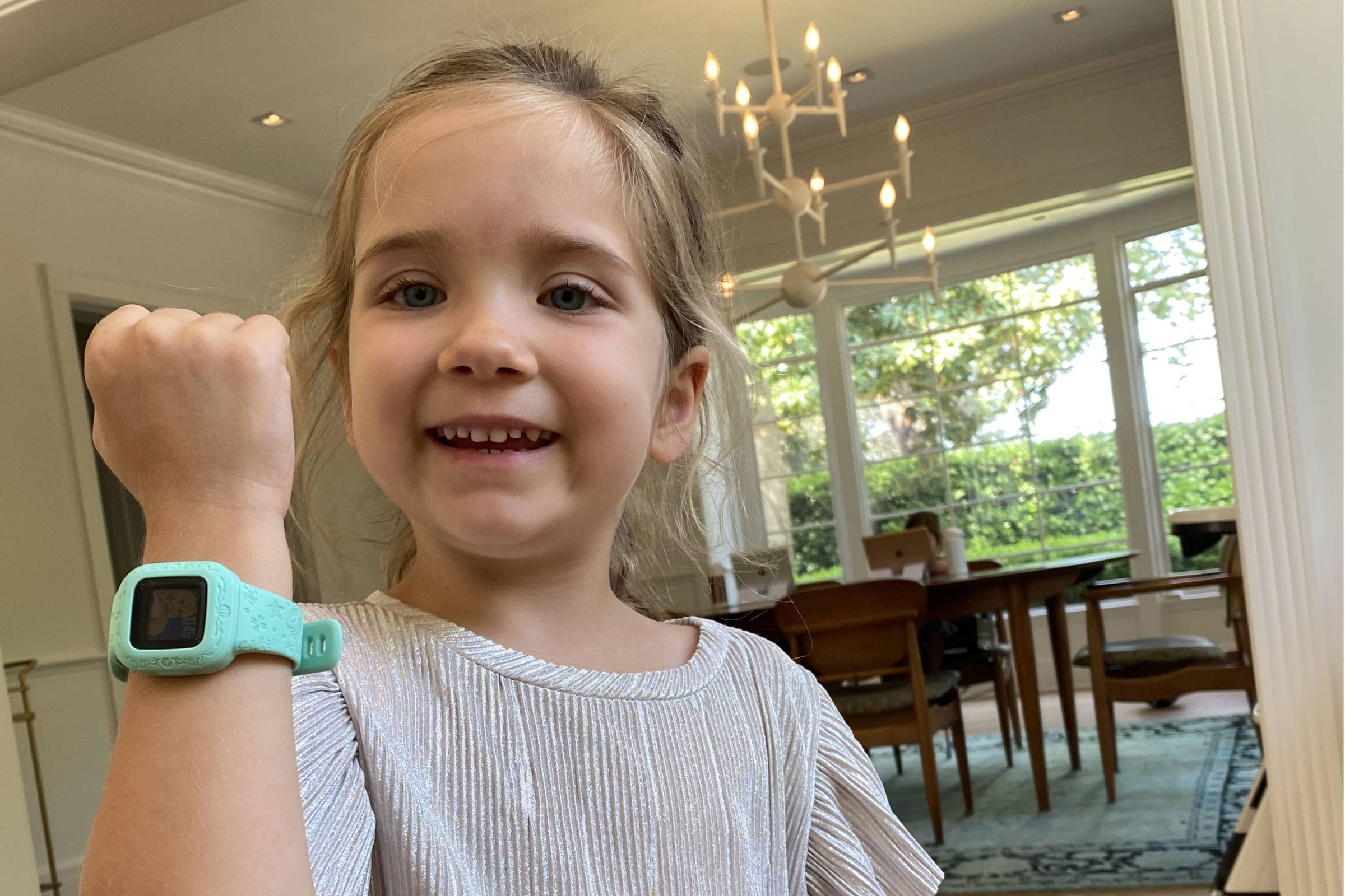 young girl showing off kids fitness trackers