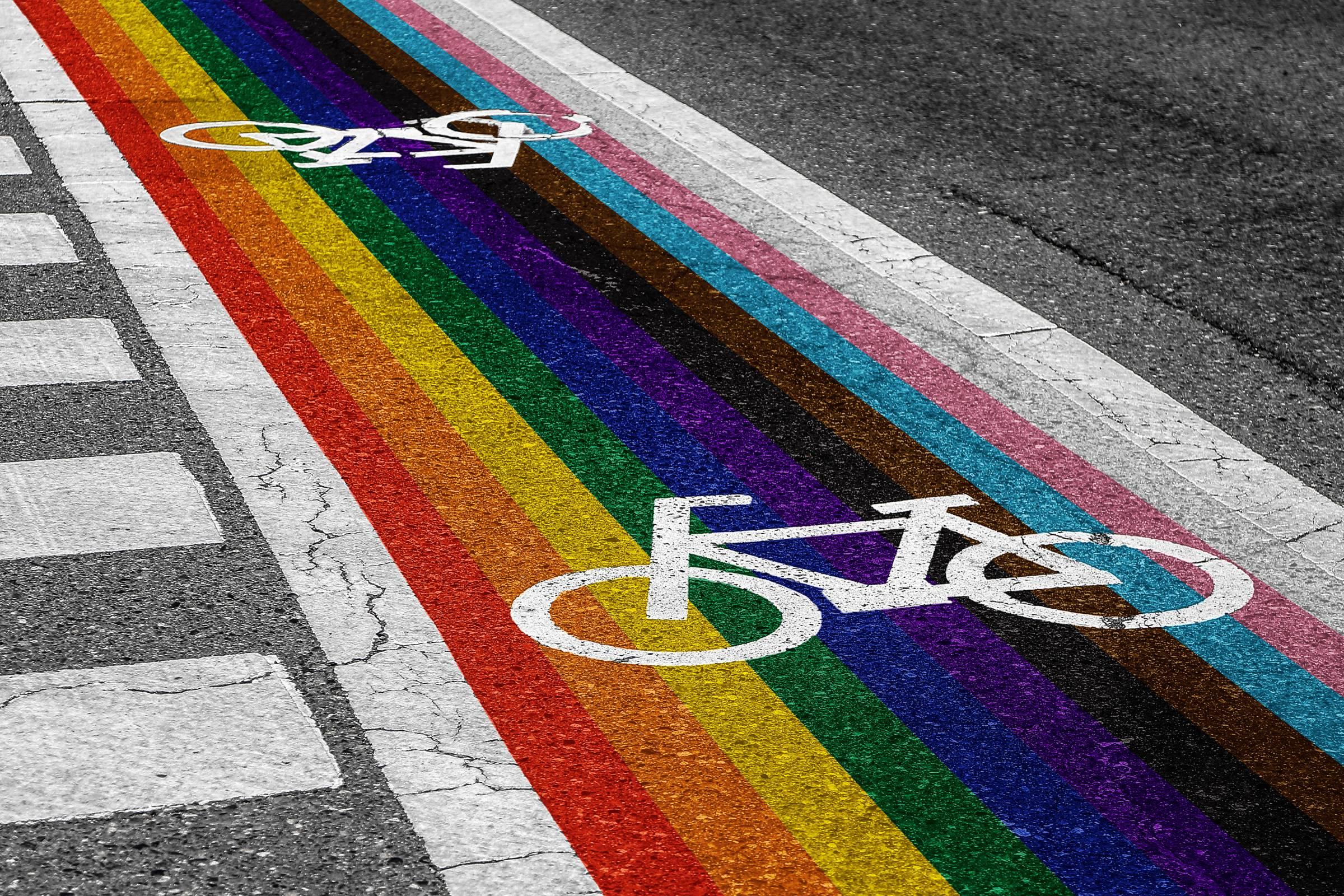 rainbow striped bike lane for pride on pavement road