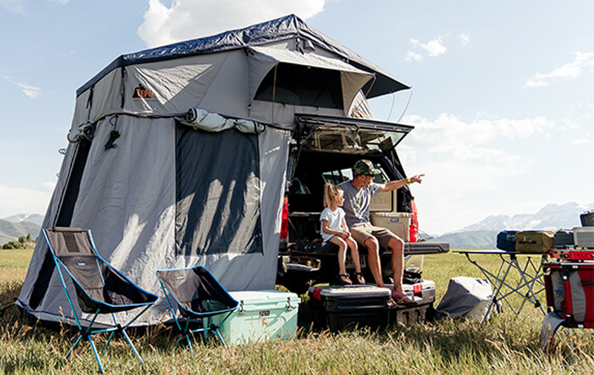 Father and Child Camping With Backcountry Gear