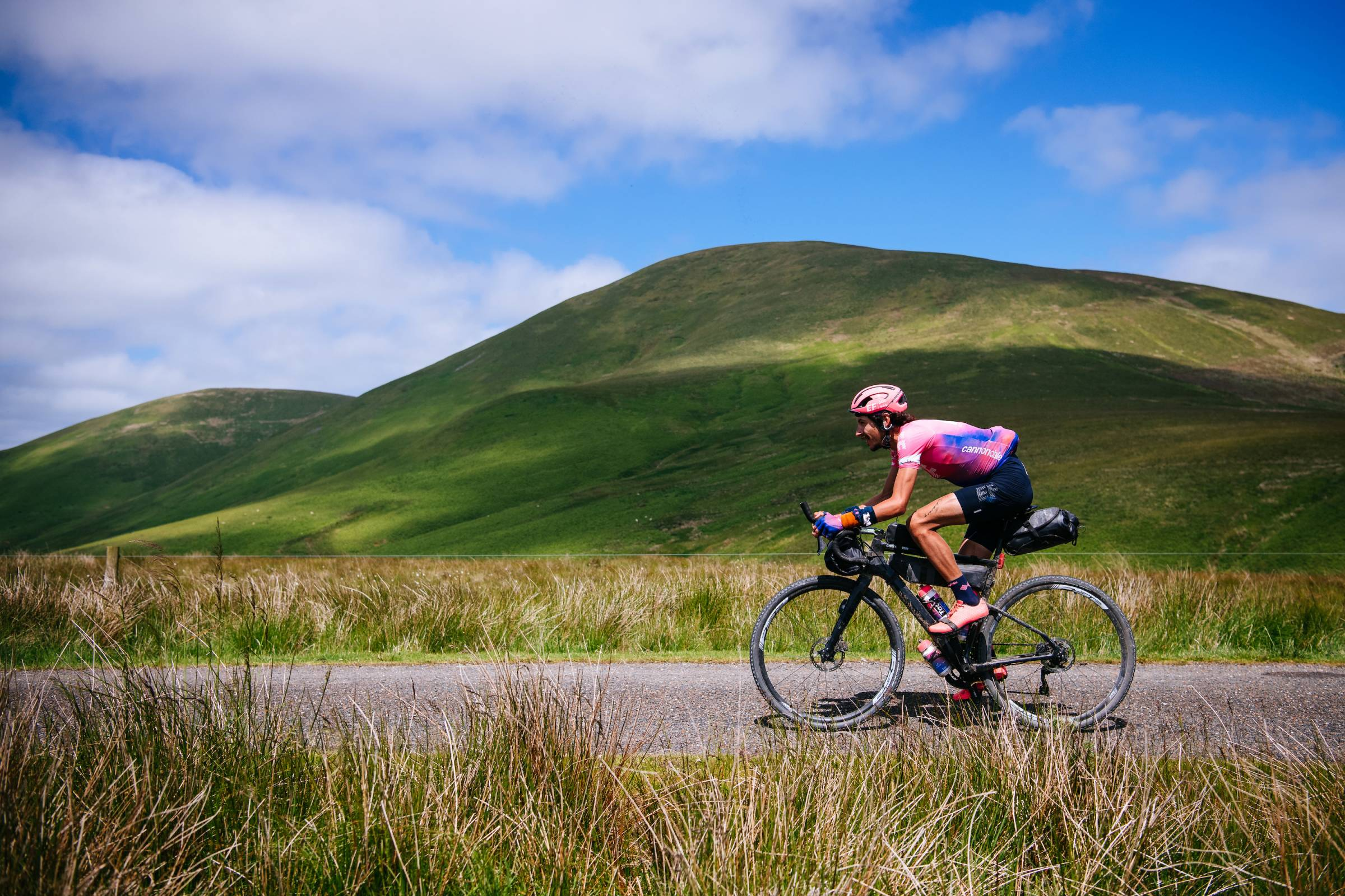 lachlan morton cycling on flat roadway in France