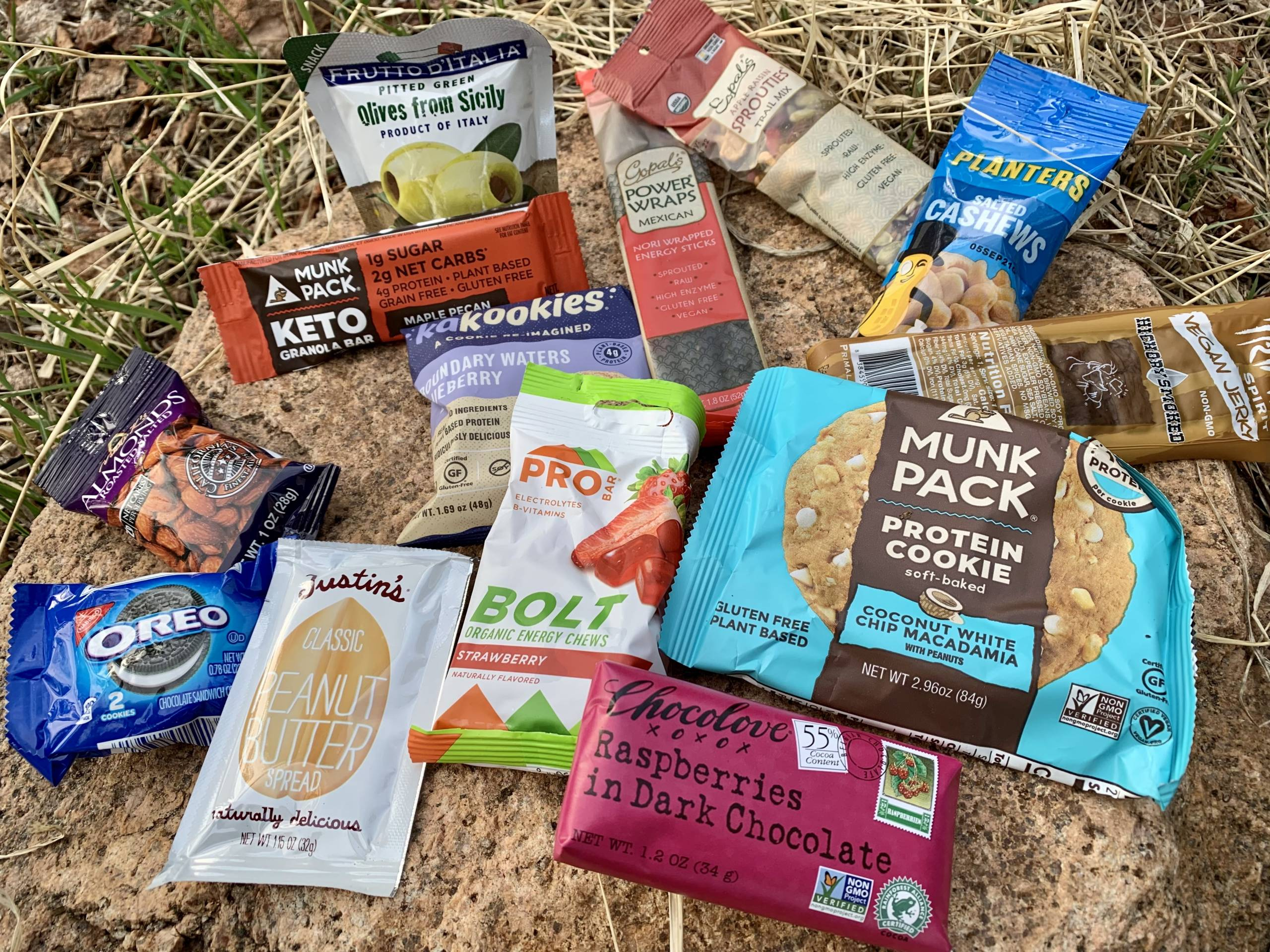 an assortment of RightOn Trek's snack options, bars, nuts, seeds, cookies, and more