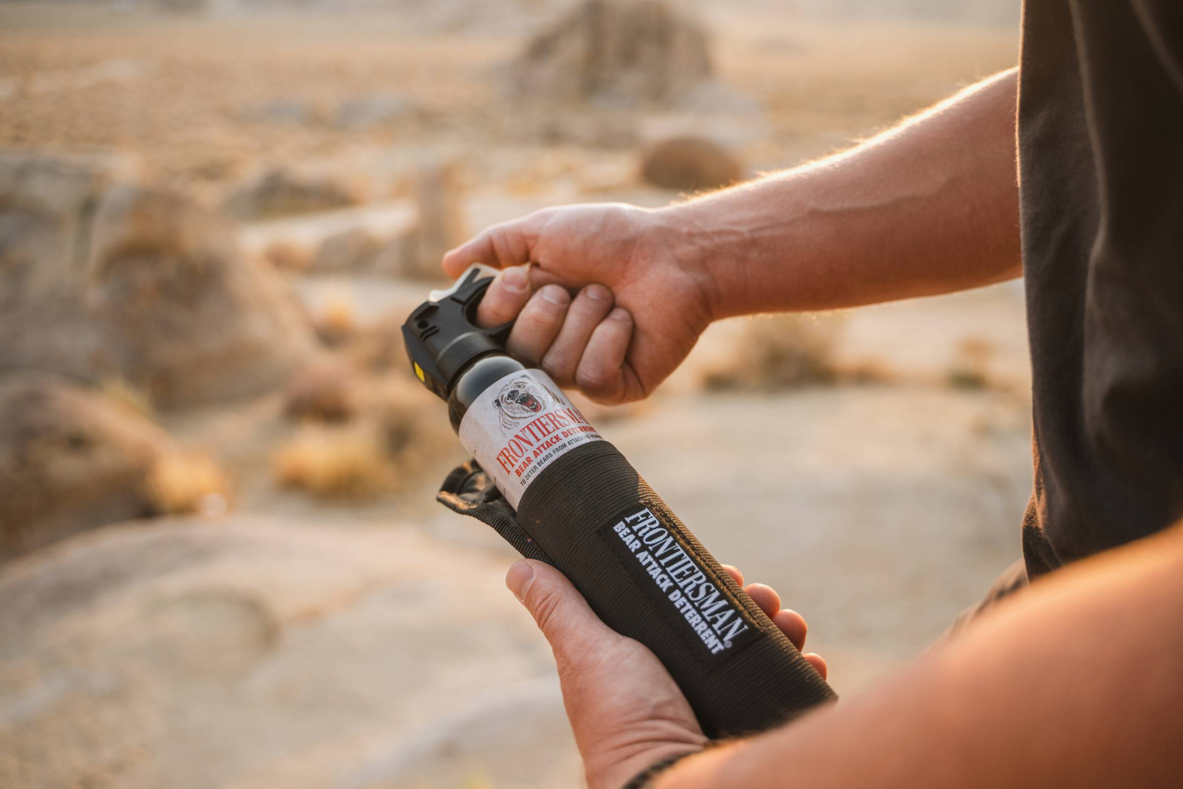 pulling frontiersman bear spray out of holster