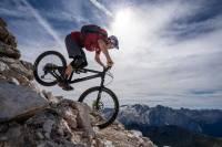 Tom Oehler mountain biking down steep rocky trail in Italy's Dolomites