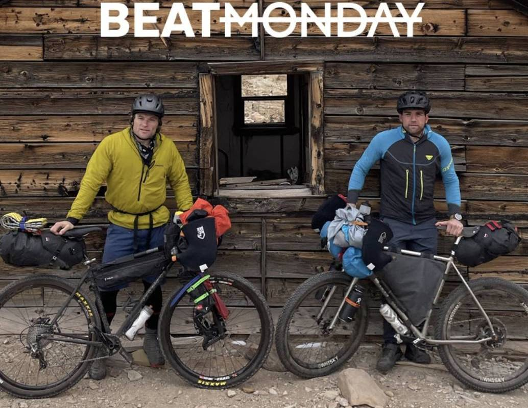 """two guys and their bikes in front of an abandoned cabin on shoot for the """"beat Monday"""" tv series"""