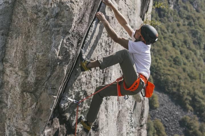 man climbing with climbing pants