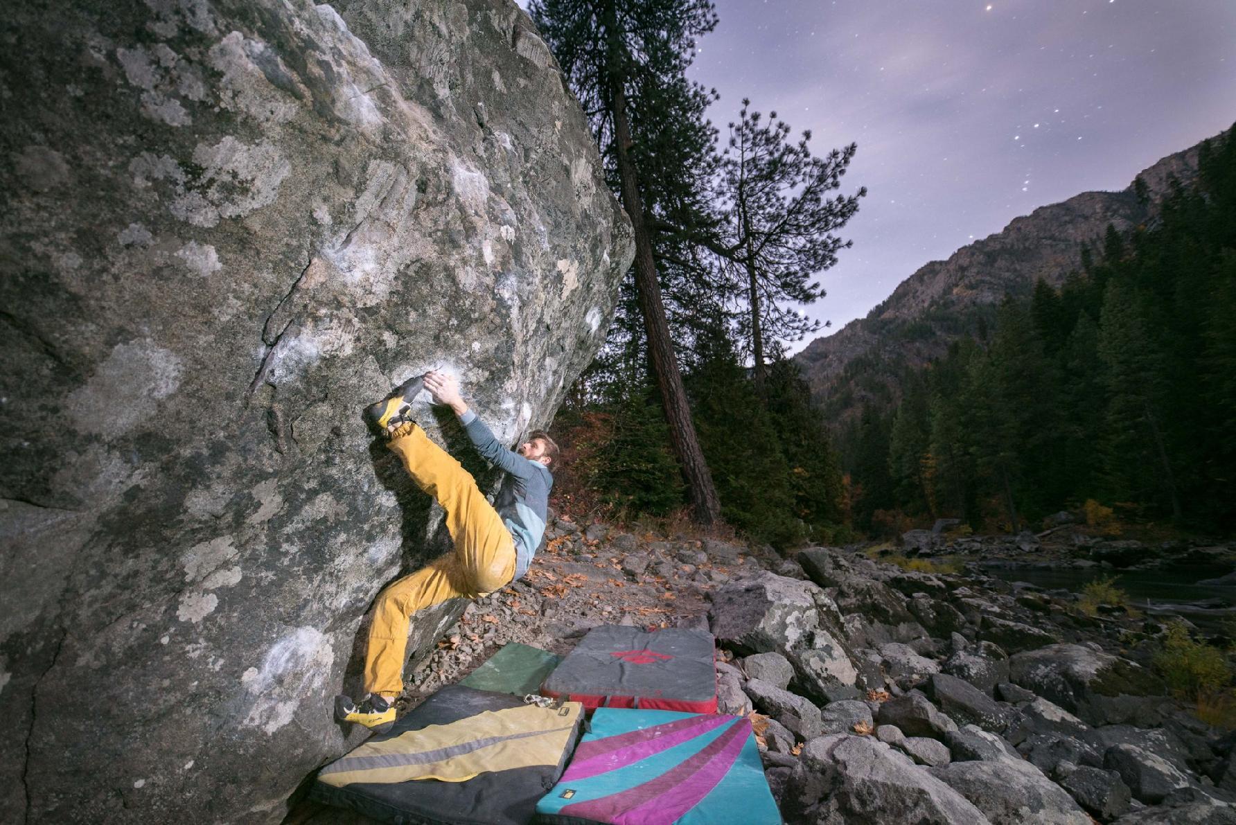man bouldering at dusk