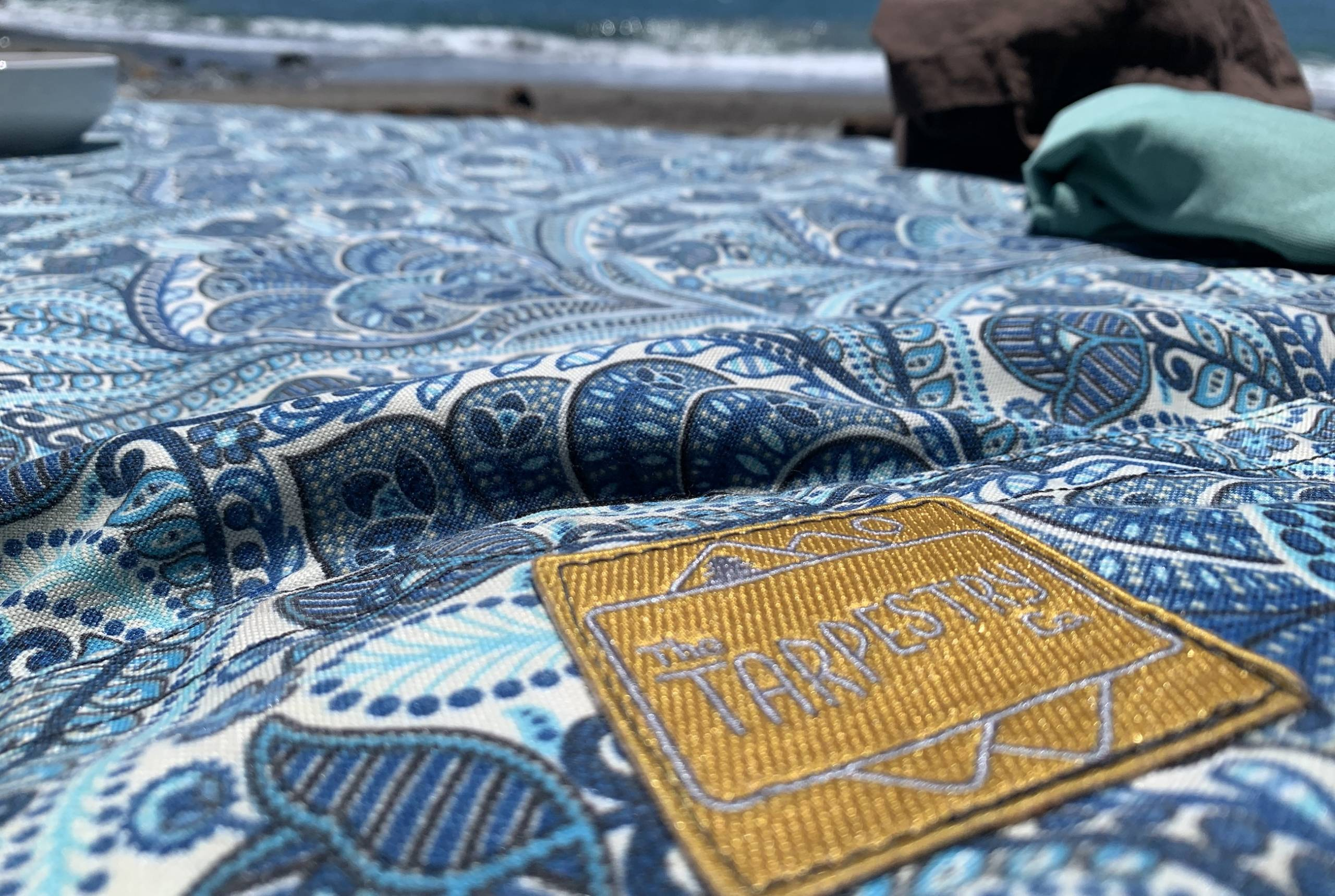 a tarpestry blanket on the beach