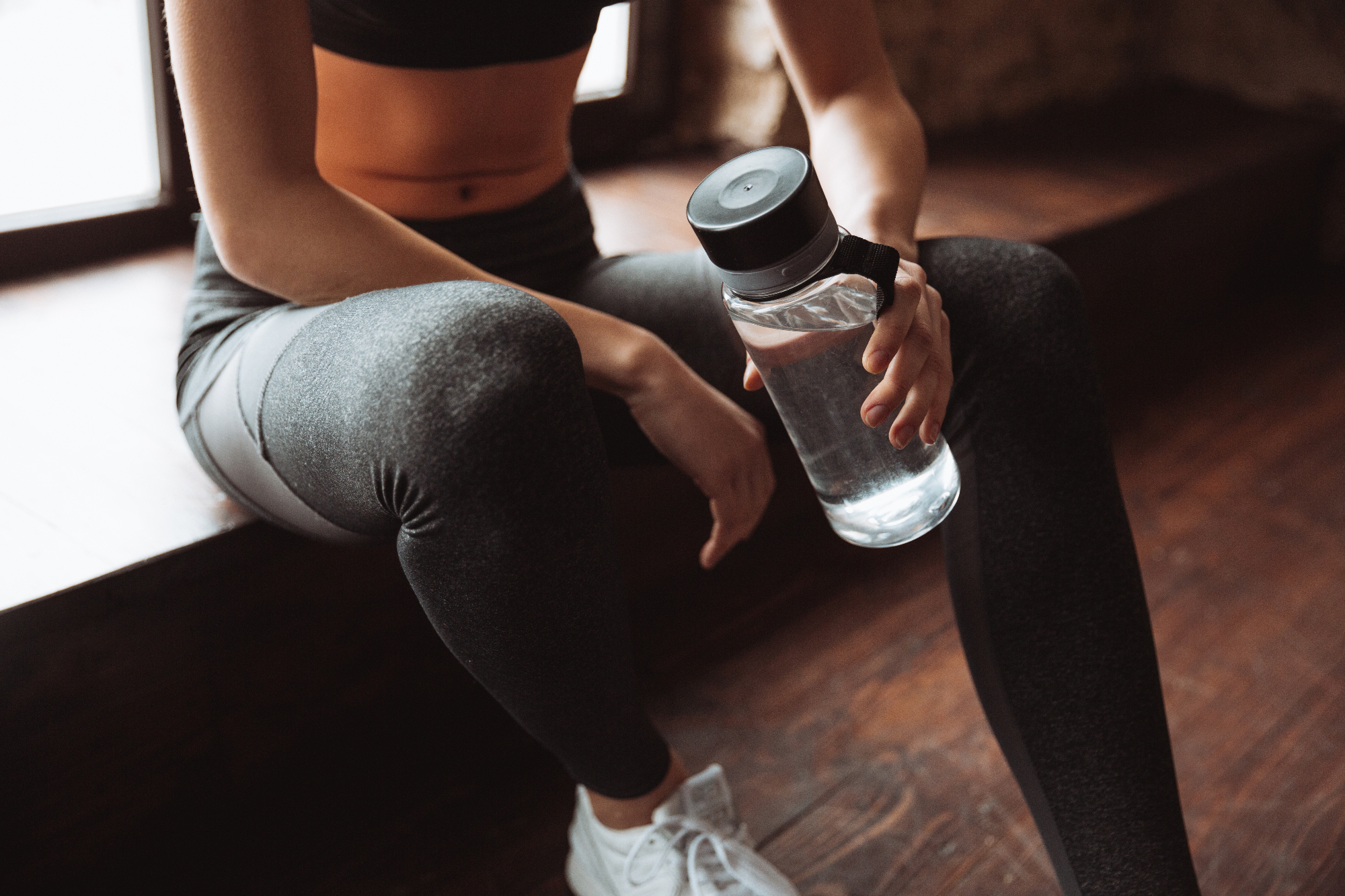 gym fitness woman drinking water