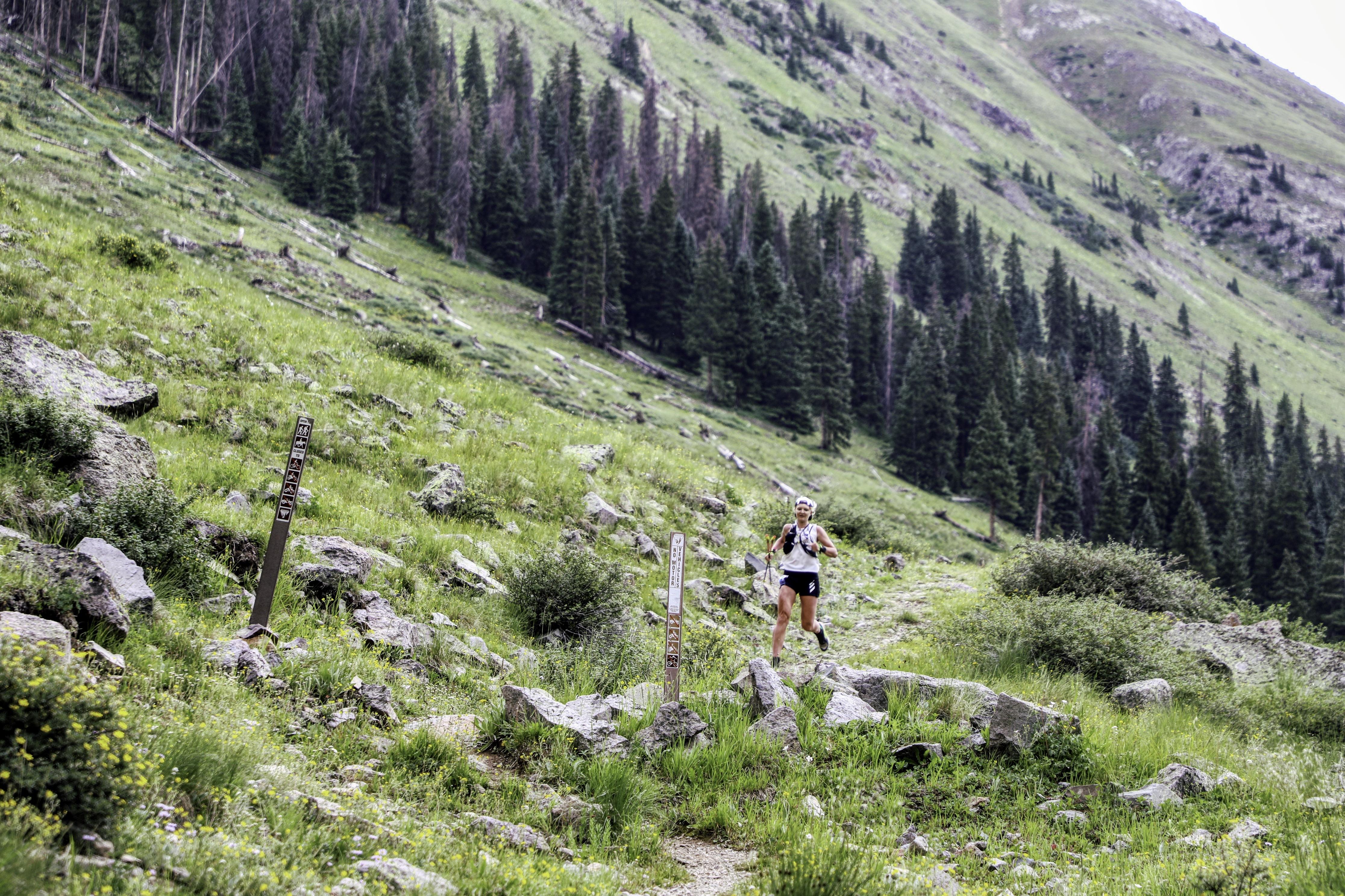 woman running in Hardrock 100 endurance race
