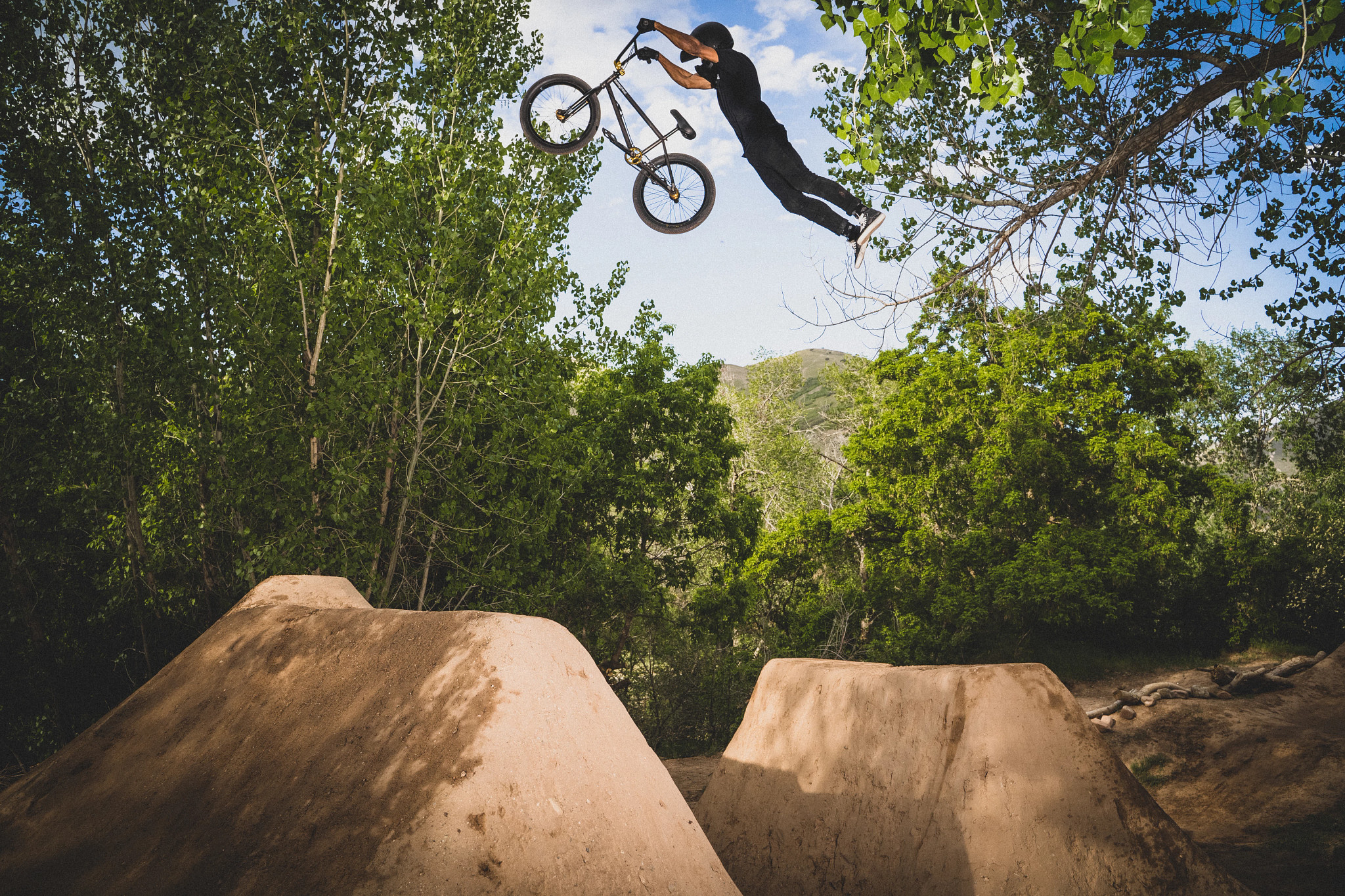 athlete pulling BMX stunt midair with legs out