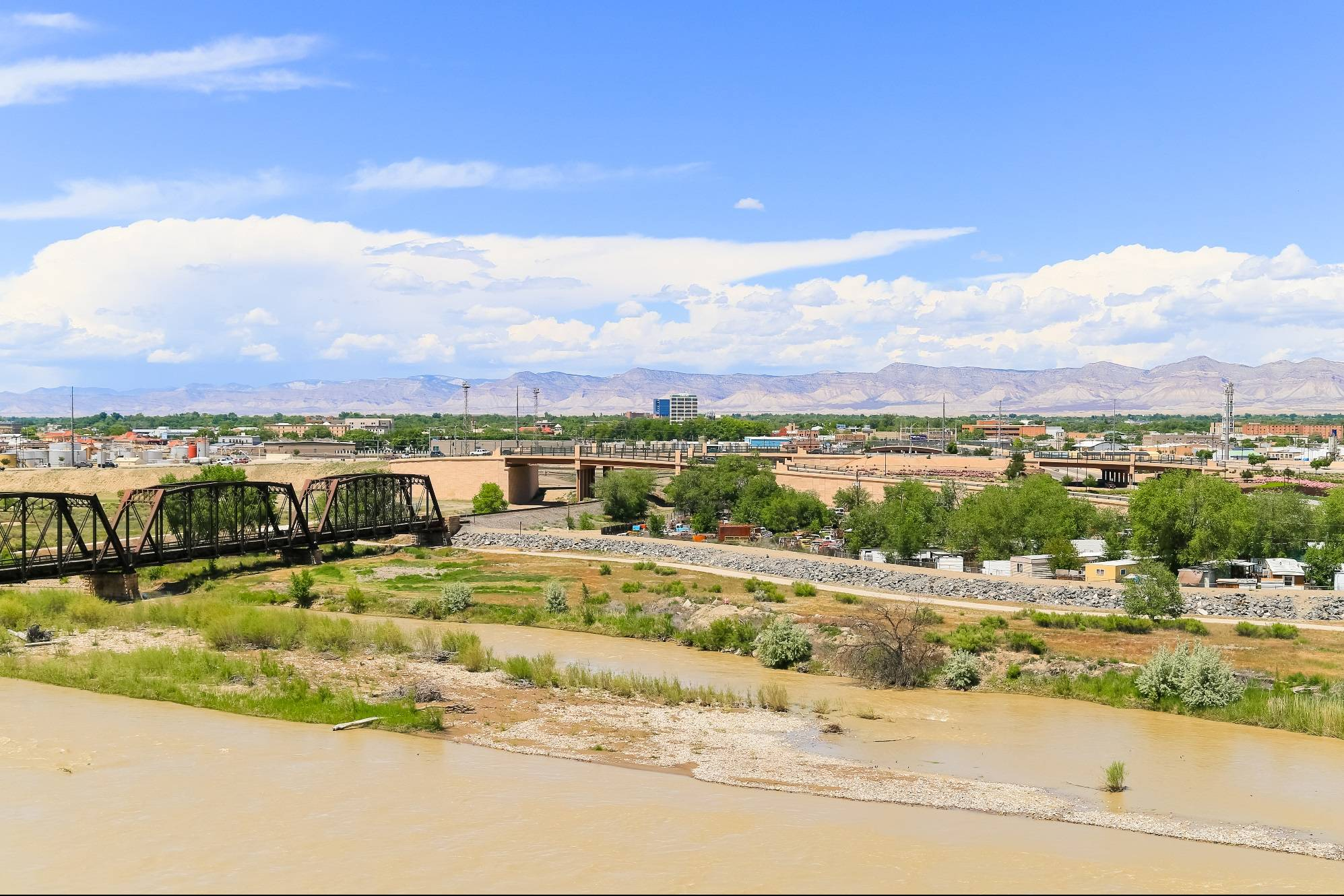 Confluence of the Colorado and the Gunnison, Grand Junction and the Book Cliffs in the background.
