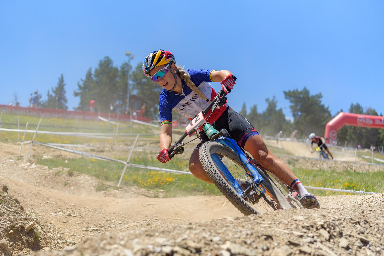 Jenny Rissveds mountain biking around tight turn on dirt course