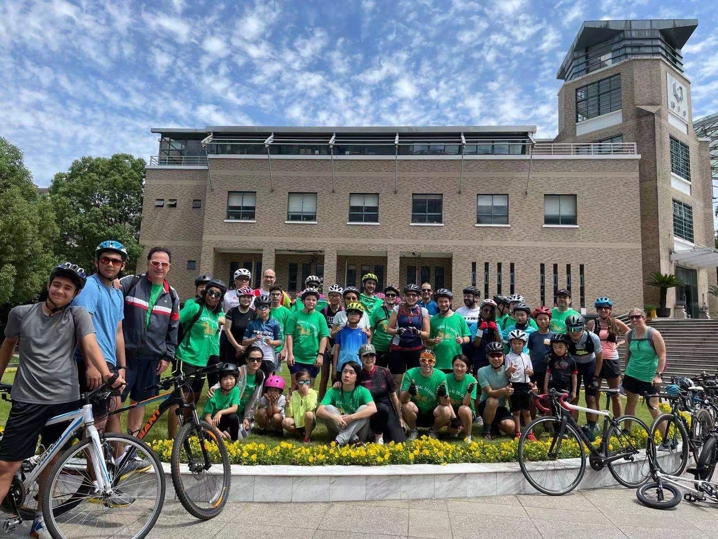 group photo pedal to empower