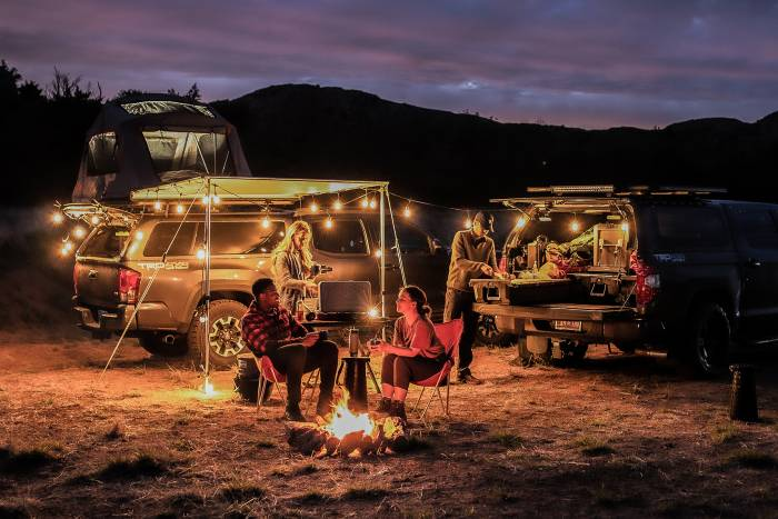 REDARC two trucks campsite at night
