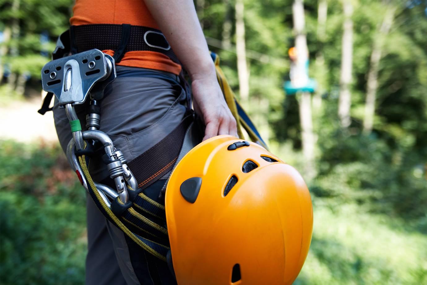 closeup of climber holding helmet