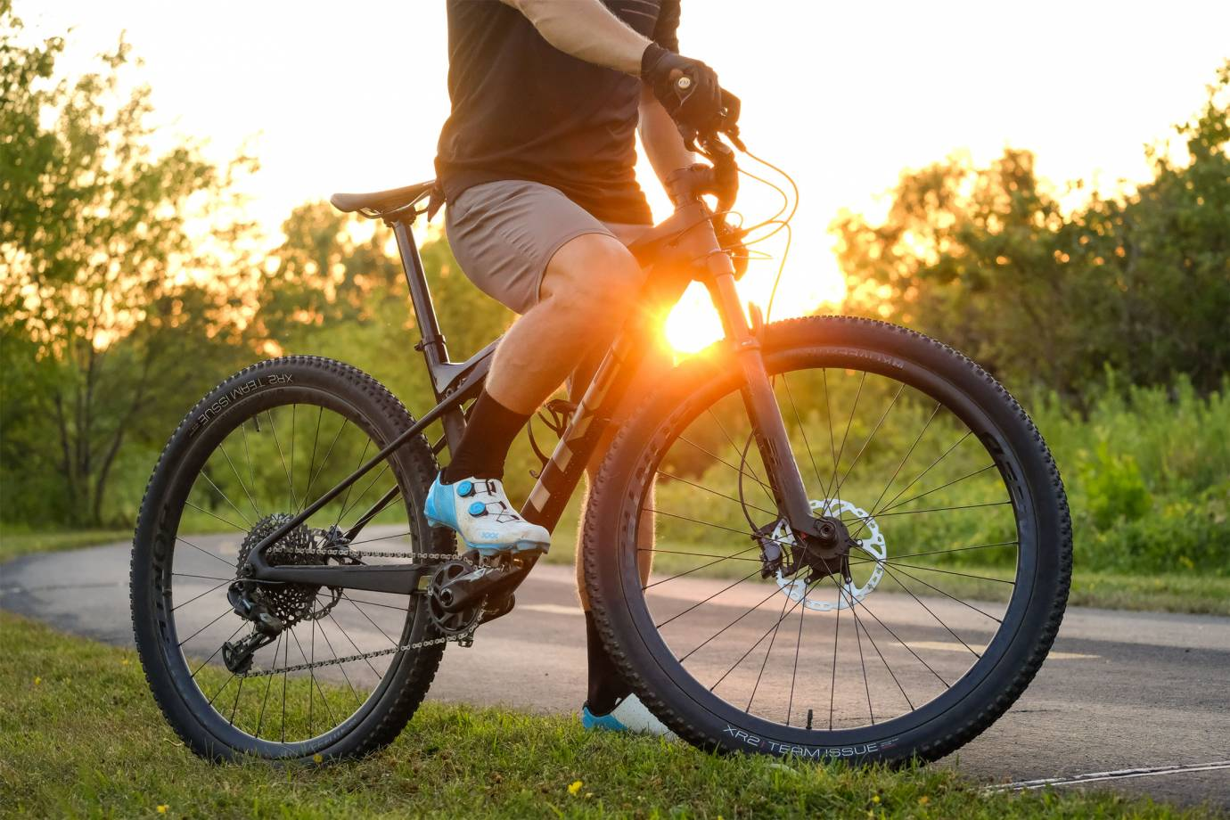 closeup of mountain bike shoes on rider at sunset