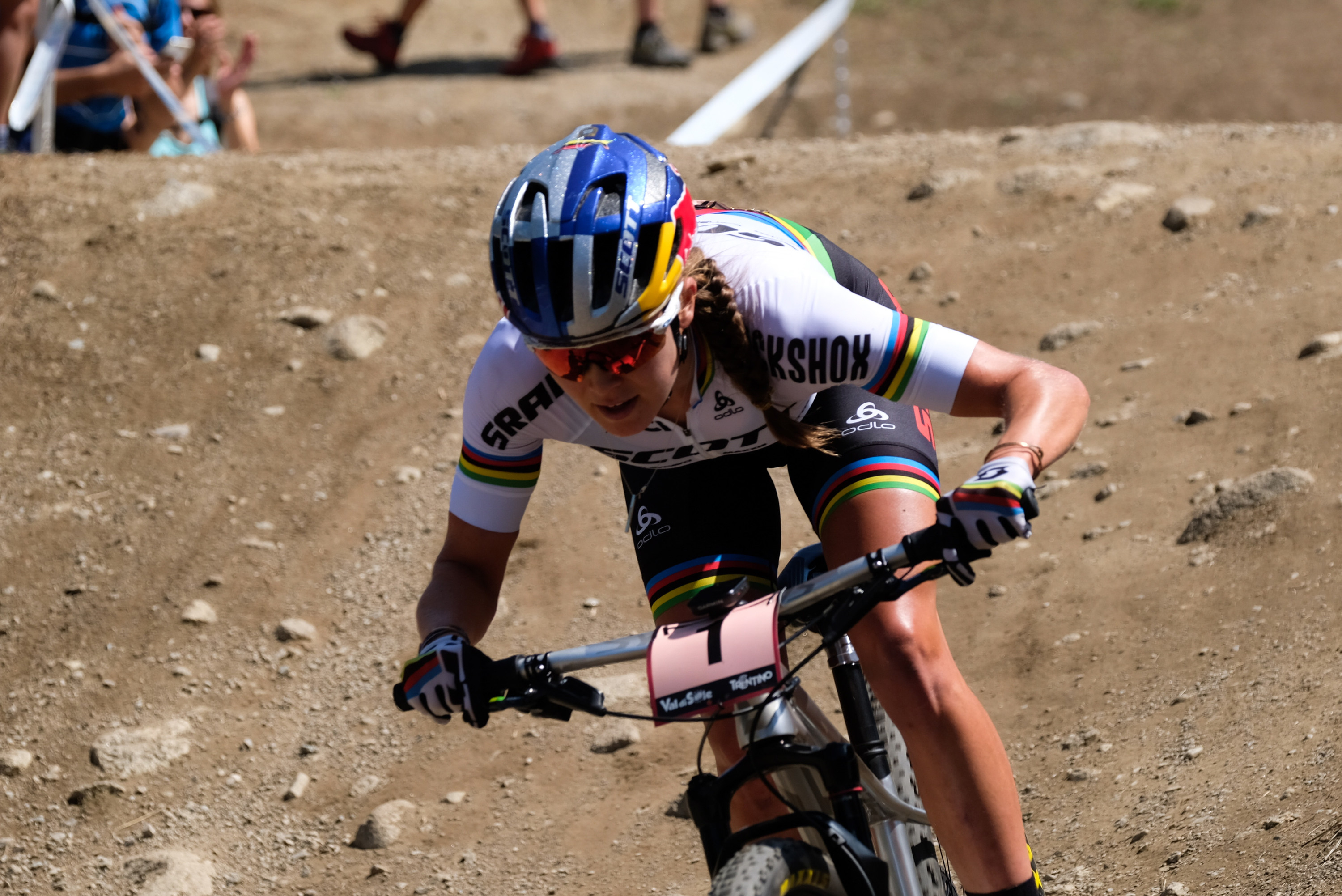 Kate Courtney mountain biking on dirt trail at a UCI World Cup