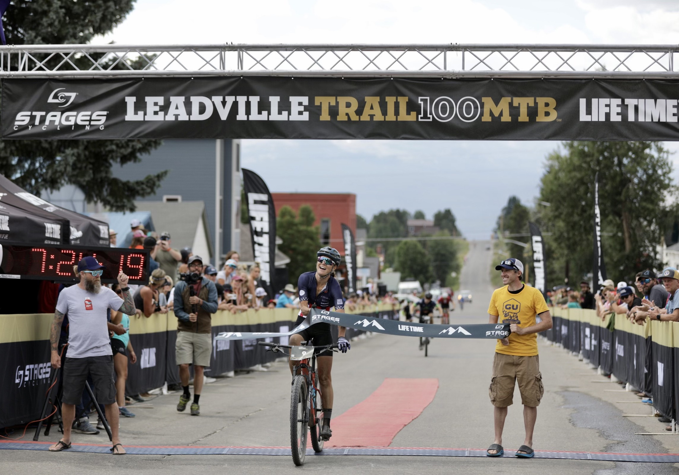 Rose Grant crossing the finish banner at the Leadville MTB