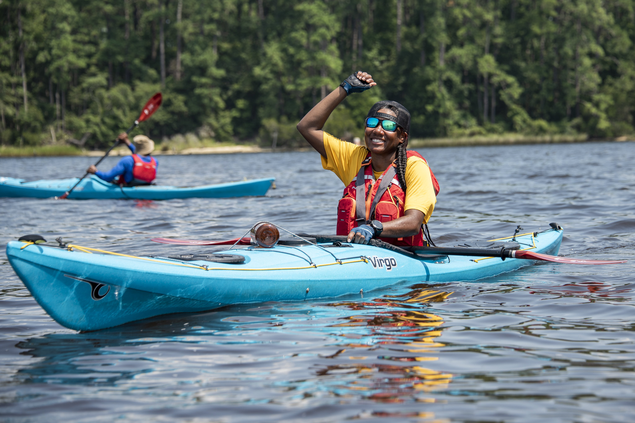 NRS outdoor afro participant paddling