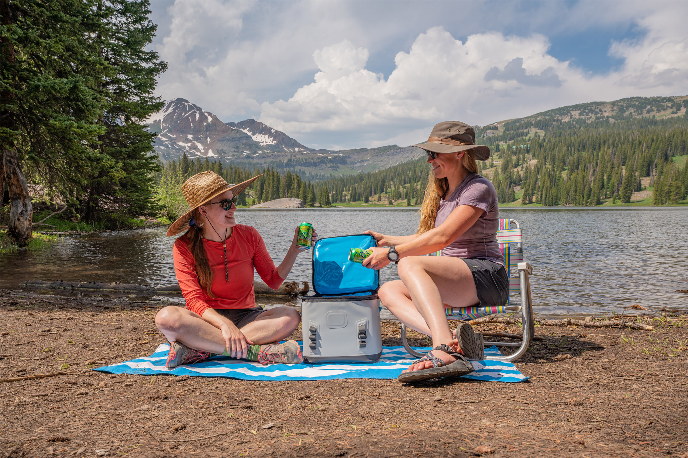 women taking drinks out of soft cooler
