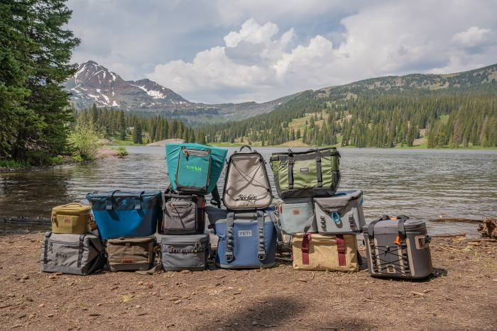 best soft coolers stacked by a lake