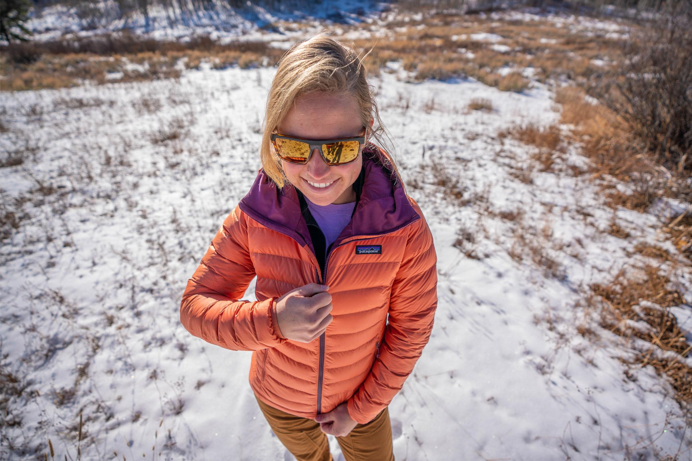 woman zipping up patagonia winter jacket