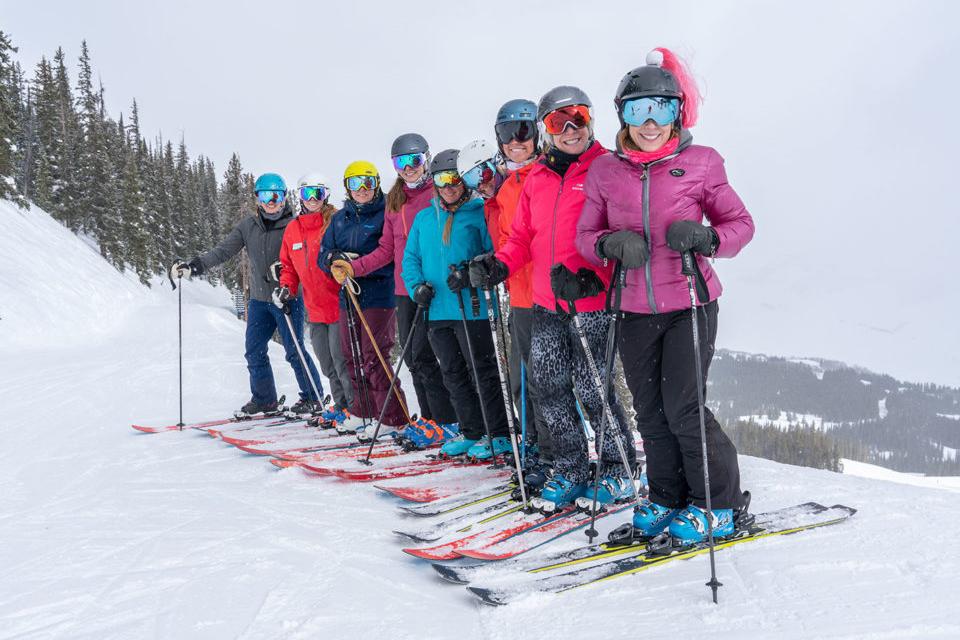 group of women skiers wearing winter jackets