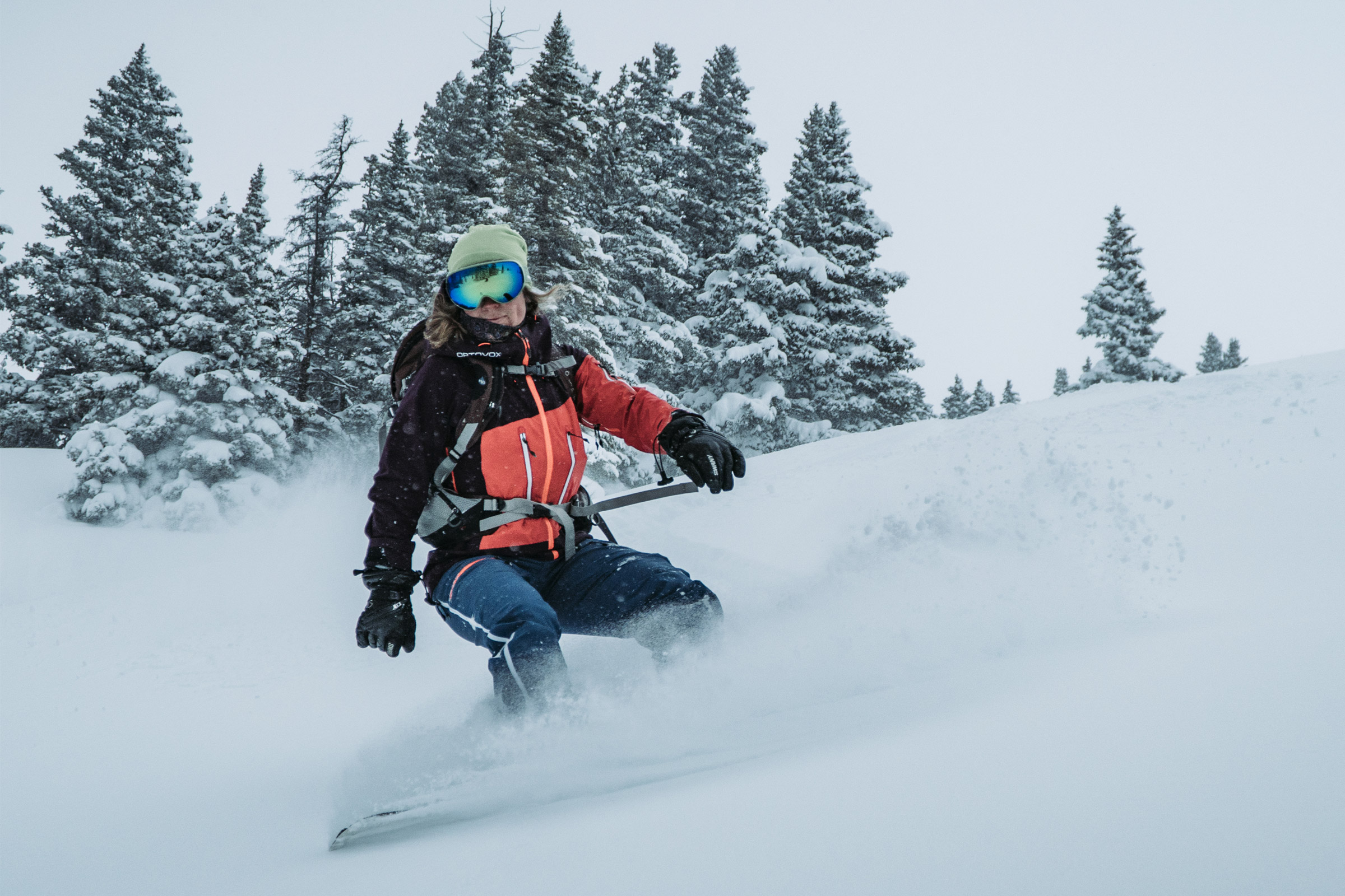 woman snowboarding in winter jacket